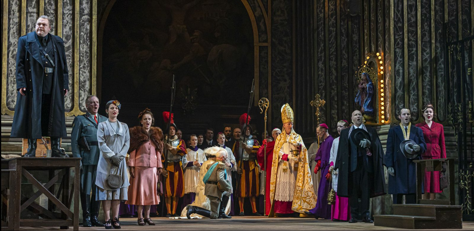 Roland Wood as Scarpia and the cast of Tosca